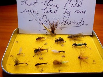A collection of flies, with authentication card, donated by Oliver Edwards.