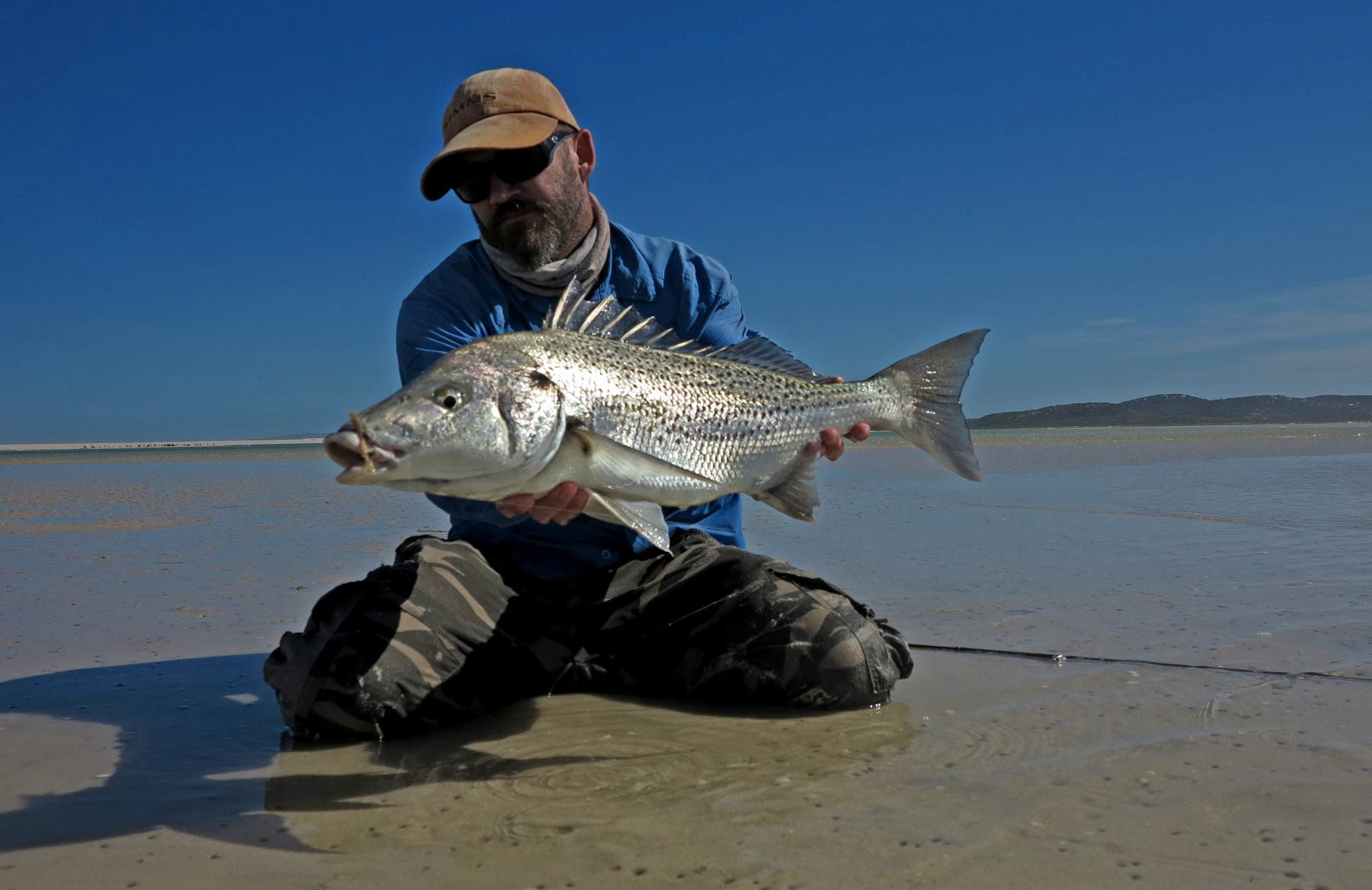 Conrad with a tank Spotted Grunter - a fish as difficult to nail as any Permit!