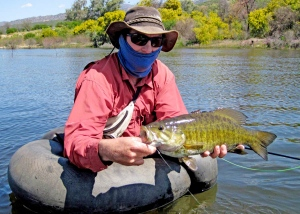 Matt Lourens with a fat smallie caught on a strike indicator rig and home made float tube.